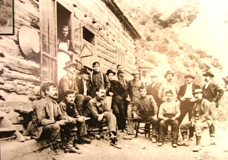 Black and White Old Photo - Miners posing in the front of a lodge